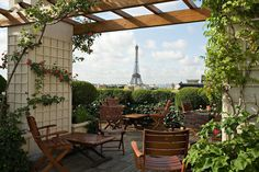 La Terrasse at Hôtel Raphael - The garden terrace at the Hôtel Raphael is a gorgeous place to grab a drink on a sunny day with views of the Eiffel Tower and Arc du Triomphe. If you want to to grab a meal, reservations are encouraged.