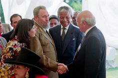 The first democratically elected President of South Africa, Nelson Mandela introduces Cuban President Fidel Castro to former South African President F.W. De Klerk.
