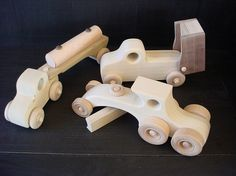 This set of construction vehicles will be the delight of any small child. The set is made from poplar, pine, birch, and black walnut wood. They have a