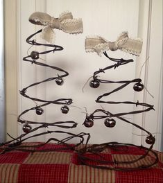 Barbed wire Christmas trees by OurNeckOfTheWoodsCO on Etsy  I would use raffia bow and rusty bells and star!