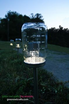 Upcycled DIY Mason Jar Solar Lights - great idea for an outdoor country wedding that goes into the night.  You can light the way to restrooms, etc.