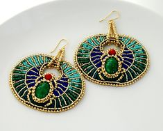 Egyptian Goddess - Geometric Bead Embroidered Statement Earrings, Egyptian Scarab Jewelry, Gold Plate, Coral, and Glass. $125.00, via Etsy.