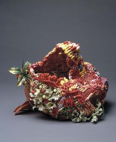 Ed Rossbach |  Christmas Basket, 1968.  synthetic ribbon, plastic found objects, macrame