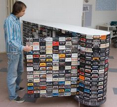 If you needed an inspiration on what to do with old cassettes, here it comes: A cassette tape closet