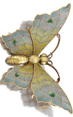 AN ART NOUVEAU ENAMEL AND DIAMOND BROOCH, LATE 19TH CENTURY. Designed as a butterfly, the wings and antennae decorated with polychrome plique-à-jour enamel, detachable brooch pin, French assay marks. #ArtNouveau #antique #brooch