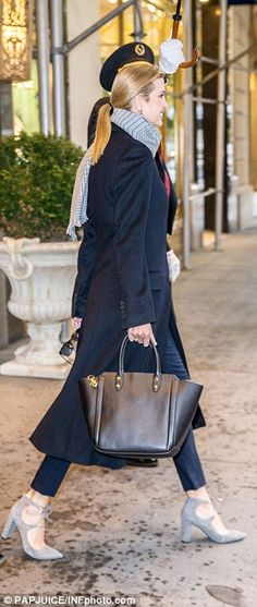 Mommy style: Ivanka accessorized her look with a black handbag and gray suede heels from her eponymous collection