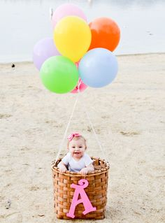 One year baby picture balloons basket