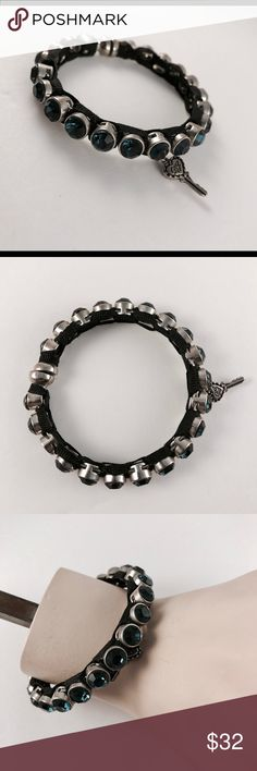 Betsey Johnson bracelet Black Betsey Johnson bracelet with magnetic clasp and navy blue stone detail Betsey Johnson Jewelry Bracelets