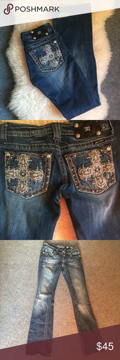 Miss Me jeans Awesome cross pocket jeans, they are in great condition... may have 2-3 studs/jewels missing, not very noticeable. Back of leg near hem torn on one leg. Bundle for discount Miss Me Jeans Boot Cut