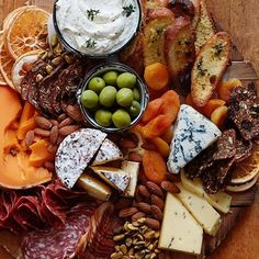 Saturday essential. This cheeseboard has everything you could ever need: Cheese, meats, nuts, dried fruits, olives, bread, YES. Tag a cheese lover. #tastingtable #cheese #cheeseboard #ttcheesy #charcuterie : @whatsgabycookin