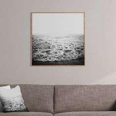 Moment at Sea Framed Wall Art - Beach walkers know to keep an eye out for the changing of tides. Photographers know the same. It's what delivers striking photos and one-of-a-kind moments at the sea.