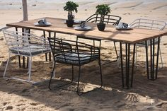 The Exo Teak Dining Table by Harmonia Living puts together two attractive materials for a truly unique outdoor dining table. Dining Table Sizes, Patio Dining Table, Teak Outdoor, Solid Wood Dining Table, Cheap Patio Sets, Teak Outdoor Furniture, Teak Dining Table, Patio Dining, Patio Dining Set