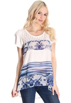 One of our most popular tops! Super soft with white and blue mixed media design concepts!