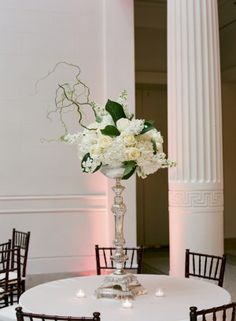 Green and white arrangement in tall silver vase by Perfect Presentations Florals and Event Design | photography by http://www.tanjalippertphotography.com/