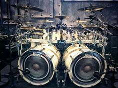 Twin Pearl kick drums with built in horn to amplify the bass hits- with microphones to ensure the sound is captured! RESEARCH #DdO:) - https://www.pinterest.com/DianaDeeOsborne/drums-drumming-joy/ - Alex Van Halen experimented with various types of unique, even crazy looking Bass Drums like this in his live set ups. In later years, some joked with respect that he had run out of weird ideas for his bass drums- they got more normal :) INFO SOURCE: pearl drummers forum. com