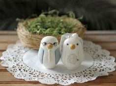 Custom cake toppers from Red Light Studios.  They'll design the birds to look like the bride and groom.  Adorable!