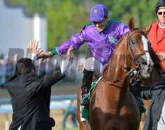 Victor Espinoza joins in the celebration with assistant trainer Alan Sherman after winning the 140th running of The Kentucky Derby aboard California Chrome. Skip Dickstein Photo