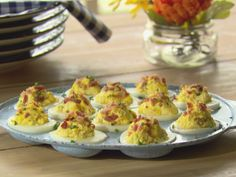 Trisha Yearwood's Sour Cream and Bacon Deviled Eggs - Tip: Very fresh eggs are hard to peel. Use eggs near the sell-by date on the carton.