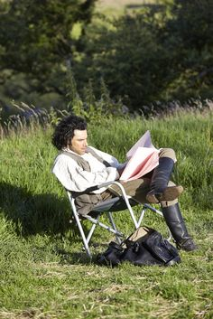 Aidan Turner who stars as Captain Ross Poldark, relaxing between takes