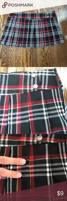 "Women's plaid mini skirt. Women's Lip Service plaid ""school girl"" skirt.  Size small. 65% polyester 35% rayon. Two small holes where a safety pin goes to complete the look. Does not come with pin. lip service Skirts Mini"