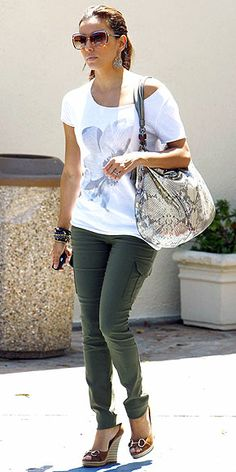 skinny cargo pants with a printed scoop-neck T-shirt, pumps and an exotic tote in Beverly Hills