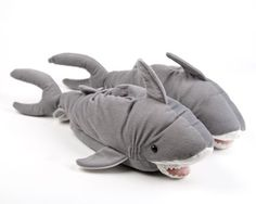 The shark animal slippers come in four sizes, ensuring a comfortable fit for every member of your gam.