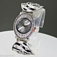 NEW!  FLEUR DE LIS ZEBRA PRINT CUFF SILVER COLOR WATCH . WATCH  HAS STAINLESS STEEL BACK WITH JAPAN  MOVEMENT. BRAND NAME IS GENEVA PLATINUM SERIES. REALLY NICE WATCH .