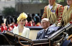 The Spanish Queen showed her sartorial credentials in an elegant pale yellow coat dress di...