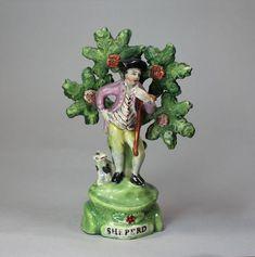 OnlineGalleries.com - English Staffordshire figure of a Shepherd, circa 1820