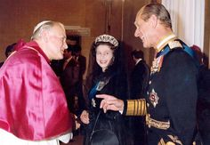 The Queen turns to smile as The Duke of Edinburgh shares a joke with Pope John Paul II during an audience at the Vatican on 17 October 1980.