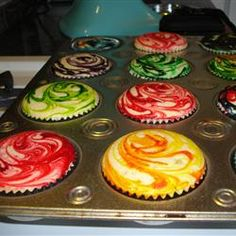 Fun for a party...White Cake - Add a couple drops of food coloring and swirl. Looks really cool! Super cool cupcakes :)