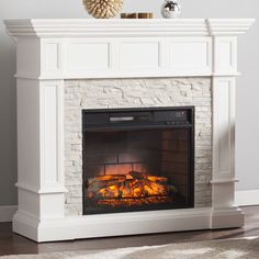 Found it at Wayfair - Frazier Faux Stone Corner Convertible Infrared Electric Fireplace