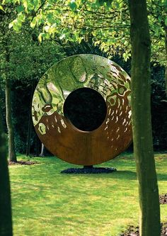The Portal is one of the Earth and Heaven series of sculptures by David Harber combining the elegance of mirror-polished stainless steel with the earthiness of oxidized steel.