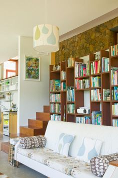I am loving the built in look of the bookcase with the contrasting white couch. I could totally read for hours here
