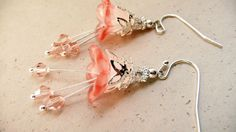 Pink and silver lucite flower dangle