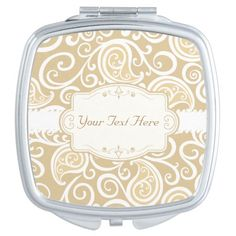 A classy compact mirror adorned with white swirls on a beige background with white swirls. This cute compact mirror has a medallion that can be personalized with a name or short saying of your choice. Great gift for any of the ladies you know, girlfriend, mom, sister and more.  Classy Beige and White Swirls Travel Mirrors