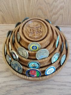 Rotating Stacked Oval Coin Display.  This one has a US Navy Master Chief Anchor in the center.  Call or PM for another emblem and size you would like.  $125.00