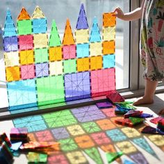 I think this might just be our new favourite way to start the day! ☀️ ~ is building up the balcony glass door with our MagnaTiles…