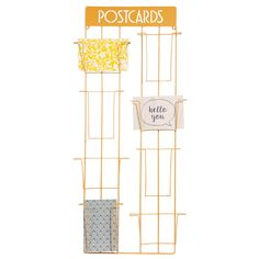 POSTCARDS metal wall hanging for photos, 31x70cm, £13, Maisons Du Monde, yellow metal