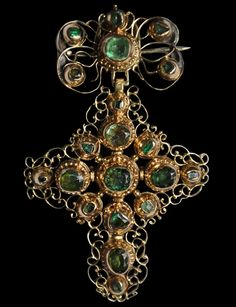 Gold Filigree Bow Cross Pendant with Columbian Emeralds. This and more important jewelry for sale on CuratorsEye.com