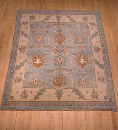 New production Ushak rug from northern Iran. Hand spun wool with natural dyes in soft blues and browns and just a hint of red. 244 x 204 cm.