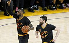 June 13, 2016; Oakland, CA, USA; Cleveland Cavaliers forward LeBron James (23) moves the ball as forward Kevin Love (0) trails behind against Golden State Warriors during the second half in game five of the NBA Finals at Oracle Arena.