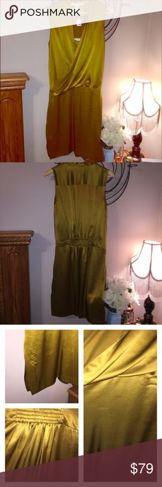 DVF 💯% silk mustard dress Good used condition. Dress is 💯% silk! Shows some signs of wear but nothing detouring. Last picture features a few runs and one small stain mark that is on the inside of the dress and could probably be removed. The side have small slots and some loose stitching. None are very noticeable when looking at the dress. Beautiful mustard color is very in this fall! Make me an offer! Diane von Furstenberg Dresses