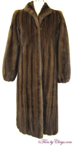 Neiman-Marcus Mahogany Mink Coat #MM766; $1200.00; Very Good Condition; Size range: 0 - 4 Average or Petite. This is a beautiful genuine natural mahogany mink fur coat. It has a Neiman-Marcus label and features a small wing-style collar, lightly elasticized sleeve ends and built-in shoulder pads.  The mink fur is very silky soft and very shiny. This gorgeous mahogany mink coat will keep you cozy as well as well-dressed at the same time! You will feel transformed when you wear it!
