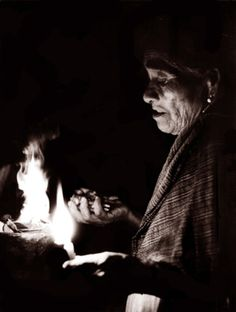 Mazatec indian shaman blessing a handfull of psilocybin mushrooms during a ceremony.