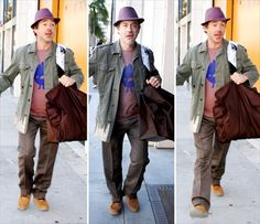 Robert Downey Jr. takes a walk in Beverly Hills on Feb. 10 with wife Susan Downey. RDJ wears an interesting outfit and in his trademark style, the 'Sherlock Holmes' star perks up and smiles for the cameras.