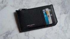 Minimal card-holder with sleek zip compartment.