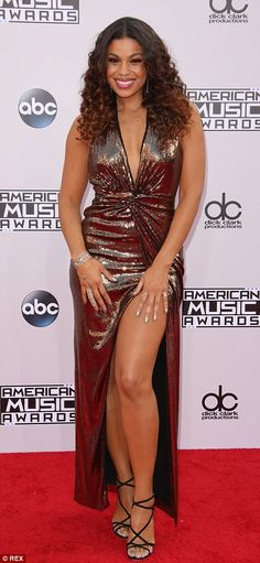 Jennifer Lopez, 45, reveals her incredibly toned stomach in daring wrap dress while Selena Gomez, 22, covers up from head to toe as the stars walk the red carpet for the American Music Awards | Daily Mail Online