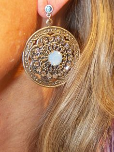Large embellished cirlce with center green stone. Find these and other unique earrings at The Prince's Table!