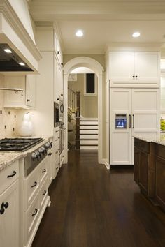 Ivory white. Many people like the look of white cabinetry in the kitchen, but they don't want the space to appear too cold. In this case, look for a white that has a slight ivory undertone. You can also add warmth to your kitchen with wood flooring, and by using clear halogen lighting. Paint pick: Atrium White by Benjamin Moore
